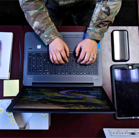 Agencies Should Emulate DOD's Telework Arrangement, IT Experts Say